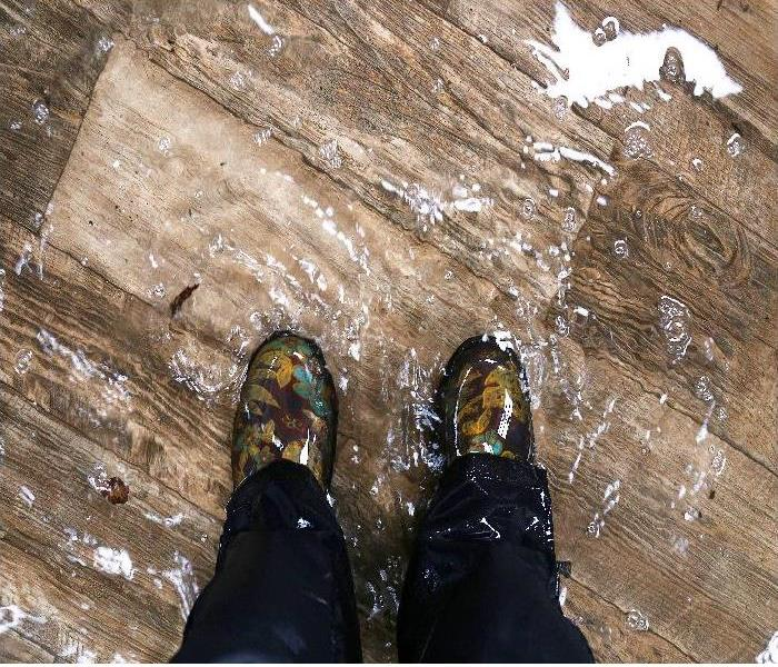 Waterproof Boots Standing in a Flooded property