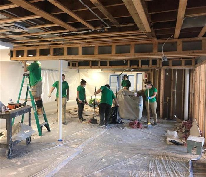 large SERVPRO Crew Cleaning and Drying a Building after a Tropical Storm